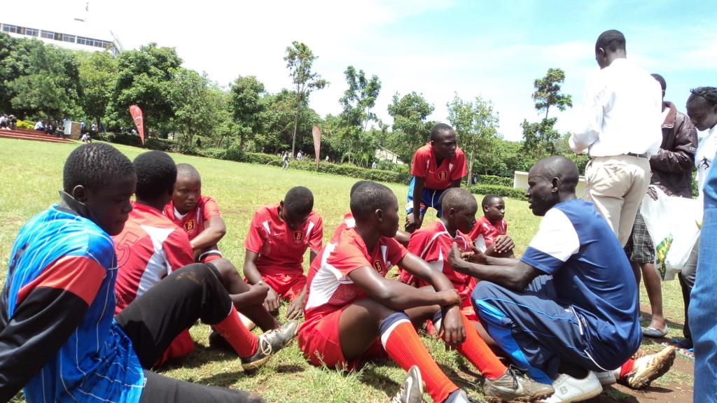 SEP Girls' Team taking instruction from Coach Maurice during KYFA Girls' Nation Wid eevent - Kisumu
